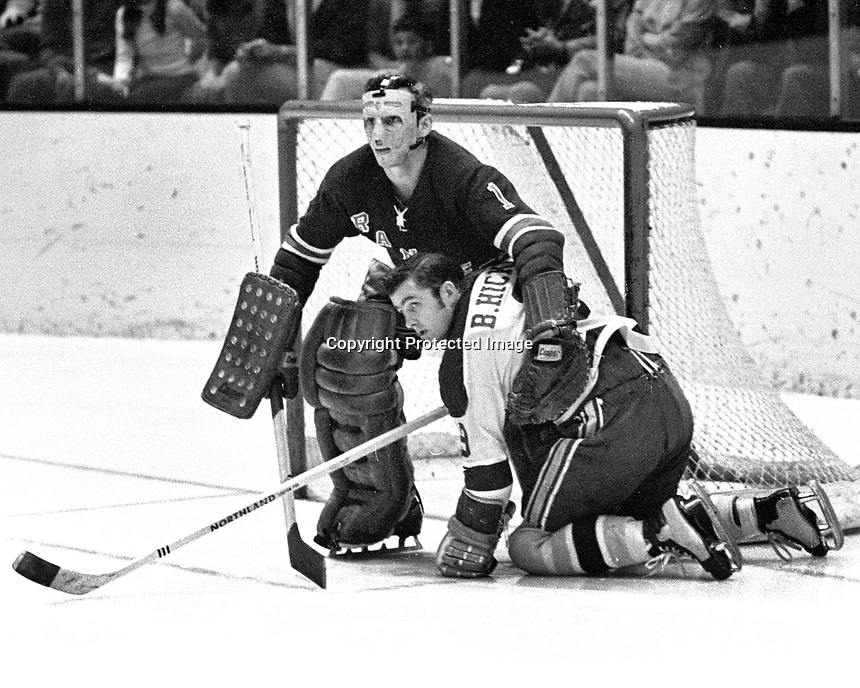 Seals Bill Hicke lands in the lap of Ranger goalie Ed Giacomin.  (1970 photo/Ron Riesterer)
