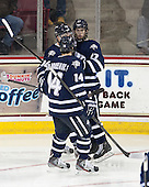 Maxim Gaudreault (UNH - 14), John Henrion (UNH - 16), Kevin Goumas (UNH - 27) - The Boston College Eagles defeated the visiting University of New Hampshire Wildcats 5-2 on Friday, January 11, 2013, at Kelley Rink in Conte Forum in Chestnut Hill, Massachusetts.