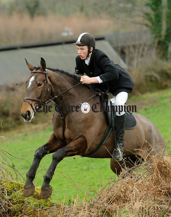 Nenagh's Andrew Nihill goes over a wall at the East Clare Harriers hunt in Broadford. Photograph by John Kelly.