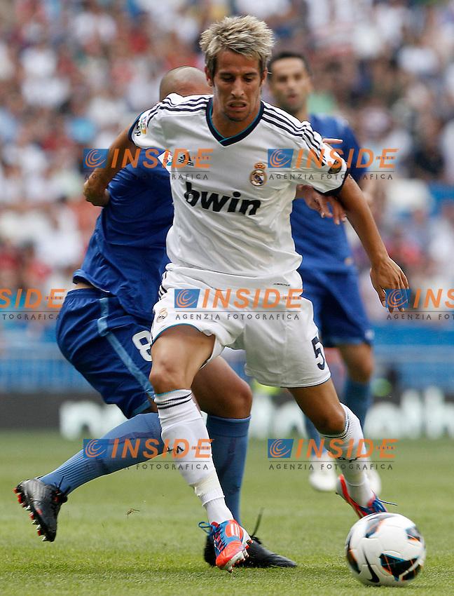 Real Madrid's Fabio Coentrao (r) and Valencia's Sofiane Feghouli during La Liga match.August 19,2012. (ALTERPHOTOS/Acero) .Madrid 19/8/2012 Stadio Santiago Bernabeu.Real Madrid Vs Valencia Liga 2012/2013.Foto Insidefoto