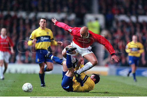 WES BROWN is tackled by Allan Jensen Ravn, MANCHESTER UNITED 5 v Brondby 0, UEFA Champions League, Old Trafford, 981104. Photo: Neil Tingle/Action Plus...1998.soccer.football.association.english premiership club clubs.tackle tackles tackling