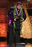 "Kalani Pe'a accepts the award for best regional roots music album for ""No 'Ane'i"" at the 61st annual Grammy Awards on Sunday, Feb. 10, 2019, in Los Angeles. (Photo by Matt Sayles/Invision/AP)"
