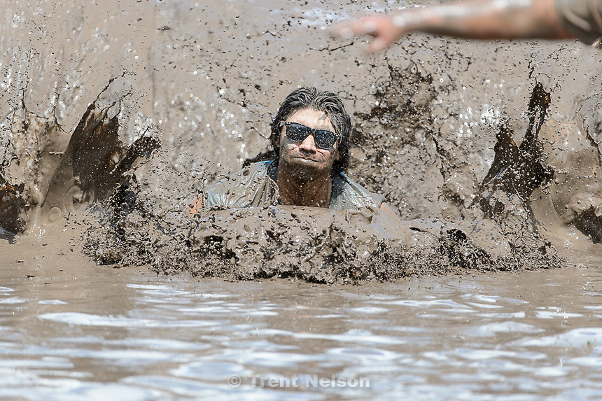 Trent Nelson  |  The Salt Lake Tribune<br /> Runners get dirty near the finish line at the Dirty Dash, held at Soldier Hollow, Saturday June 6, 2015.