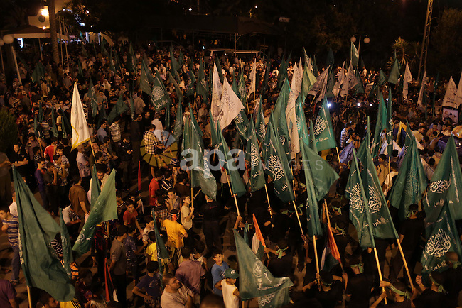 Palestinian Hamas supporters hold movement flags during a rally marking 13th anniversary of the so-called Al-Aqsa uprising or 'Second Intifada', in Gaza City, 26 September 2013. Palestinians marked the 13th anniversary of the Second Intifada, or Palestinian Uprising, which began in September 2000 after the breakdown of US-mediated peace talks between Israel and the Palestinians, which was compounded by a visit to Temple Mount, considered sacred by both Jews and Muslims, by former Israeli Prime Minister Ariel Sharon. Photo by Ashraf Amra