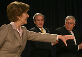 United States President George W. Bush, center, US Senator Mike Enzi (Republican of Wyoming), right and first lady Laura Bush, left, arrive at their seats at the 56th National Prayer Breakfast at the Washington Hilton Hotel  in Washington, DC. on February 7, 2008. <br /> Credit: Dennis Brack / Pool via CNP