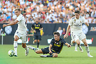 Landover, MD - August 4, 2018: Real Madrid midfielder Marcos Llorente (18) gets the ball from Juventus forward Nicolo Fagioli during the match between Juventus and Real Madrid at FedEx Field in Landover, MD.   (Photo by Elliott Brown/Media Images International)