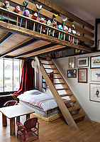 The girls' bedrooms are situated on a mezzanine connected with an open staircase made of wood