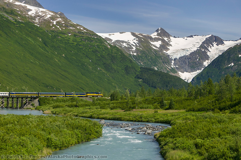Alaska Railroad passenger train crosses trestle over Placer creek, Chugach mountains, enroute to Whittier, Alaska