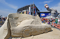 Jun 1, 2008; Dover, DE, USA; NASCAR Sprint Cup Series fans congregate around a sand sculpture of former driver Bobby Allison and Miles the Monster, the mascot of the track, prior to the Best Buy 400 at the Dover International Speedway. Mandatory Credit: Mark J. Rebilas-US PRESSWIRE