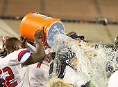 Manatee Hurricanes Darius White #52 and Leon Allen #7 dump the water on head coach Joe Kinnan during the fourth quarter of the Florida High School Athletic Association 7A Championship Game at Florida's Citrus Bowl on December 16, 2011 in Orlando, Florida.  Manatee defeated First Coast 40-0.  (Photo By Mike Janes Photography)