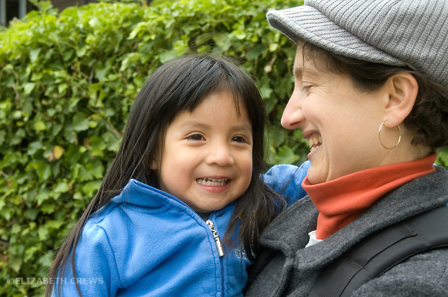 Berkeley CA Guatemalan girl, three years old, and adoptive mother enjoying each other  MR