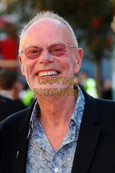 Bob Harris.Arrivals to the UK Premiere of 'George Harrison: Living In The Material World' at BFI Southbank, London, England..October 2nd, 2011.headshot portrait black glasses tinted  stubble blue shirt facial hair .CAP/CJ.©Chris Joseph/Capital Pictures.