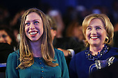 Hillary Rodham Clinton and daughter Chelsea Clinton are viewed in the audience as President Barack Obama, who is in New York City for the 69th Session of the United Nations General Assembly, speaks at the Clinton Global Initiative on September 23, 2014 in New York City. World leaders, activists and protesters have converged on New York City for the annual UN event that brings together the global leaders for a week of meetings and conferences. This year 's General Assembly has highlighted the problem of global warming and how countries need to strive to  reduce greenhouse gas emissions. <br /> Credit: Spencer Platt / Pool via CNP