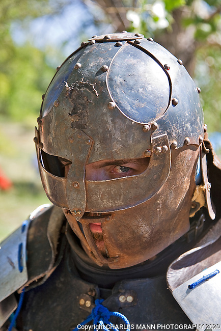 "The Renaissance Fair is held each September at the historic museum of El Rancho de Las Golondrinas near Santa Fe and features dancers, kinghts, acrobats and many other performers all celebrating the culture and life style of the Medieval Middle Ages.  Knights in home made armor from the Society for Creative Anachronism do battle  to vie for the favor of the  King and Queen. Armor maker Michael Grimm portrays ""The Right Honorable Thaign Tempus."""