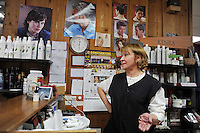 Linda Swihart, 59, of Sturgis, Michigan, owner of the Sheer Style salon on highway 131, is seen inside her salon on the main thoroughfare of Constantine, Michigan on December 22, 2010. Swihart said many local businesses closed up in recent years including the more up-market hair salon in the town of Sturgis where she lives.