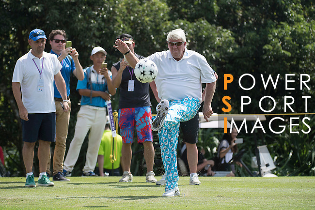 John Daly kicks a football during the World Celebrity Pro-Am 2016 Mission Hills China Golf Tournament on 23 October 2016, in Haikou, Hainan province, China. Photo by Weixiang Lim / Power Sport Images