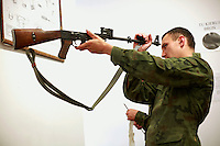 Private Andrzej Kasprzak cleaning his AK-47 Kalashnikov rifle after shooting. This year's class of drafted recruits is the final one after 90 years of compulsory military service, as Poland's army turns professional in 2009.