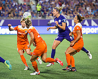 Orlando, Florida - Saturday, April 23, 2016: Orlando Pride midfielder Becky Edwards (14) heads the ball between three opponents during an NWSL match between Orlando Pride and Houston Dash at the Orlando Citrus Bowl.