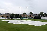 The covers are on the outfield as rain delays play during Essex CCC vs Somerset CCC, Specsavers County Championship Division 1 Cricket at The Cloudfm County Ground on 30th August 2017