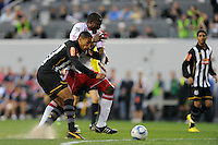 Bruno Aguiar (2) of Santos FC and Ibrahim Salou (29) of the New York Red Bulls battle for the ball during the first half of a friendly between Santos FC and the New York Red Bulls at Red Bull Arena in Harrison, NJ, on March 20, 2010. The Red Bulls defeated Santos FC 3-1.