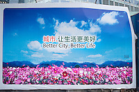 Daytime landscape view of the Better City Better Life Logo And Signage in Pudong.  © LAN