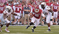 STAFF PHOTO BEN GOFF  @NWABenGoff -- 09/20/14 <br /> Arkansas quarterback Brandon Allen carries the ball during the first quarter of the game against Northern Illinois in Reynolds Razorback Stadium in Fayetteville on Saturday September 20, 2014.