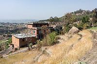 Bhaktapur, Nepal.  Rural House.  Changu Narayan Temple on Hilltop in Distance.