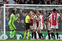 Ajax players gather around referee, Gianluca Rocchi after he awards Chelsea their second penalty during Chelsea vs AFC Ajax, UEFA Champions League Football at Stamford Bridge on 5th November 2019