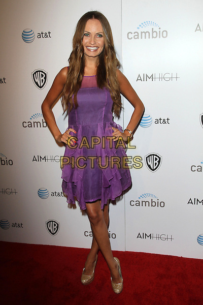 """Mia Hope.""""Aim High"""" Los Angeles Premiere held at Trousdale, West Hollywood, California, USA..October 18th, 2011.full length purple dress hands on hips.CAP/ADM/KB.©Kevan Brooks/AdMedia/Capital Pictures."""