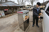 David Blaisus (cq), with the Flourish Company, pumps gas Thursday, January 10, 2020, at Ahart's Grocery in St. Paul. A Dollar General store is opening in the town and is located next to Ahart's that is the only store that sells gas in the town. Check out nwadg.com/photos for today's photo gallery.<br /> (NWA Democrat-Gazette/David Gottschalk)