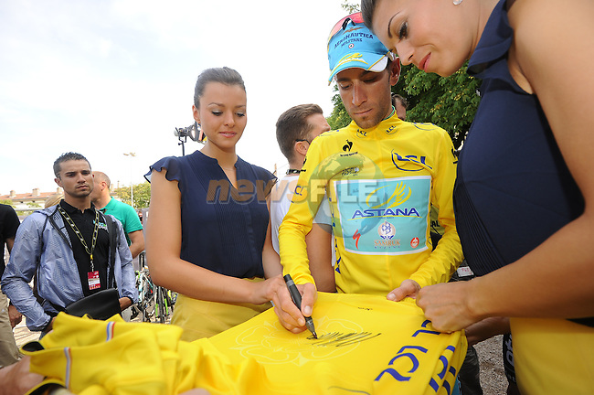 Sprinter Nacer Bouhanni (FRA) watches as Vincenzo Nibali (ITA) Astana retains the leader's Yellow Jersey at the end of Stage 7 of the 2014 Tour de France running 234.5km from Epernay to Nancy. 11th July 2014.<br /> Photo ASO/X.Bourgois/www.newsfile.ie