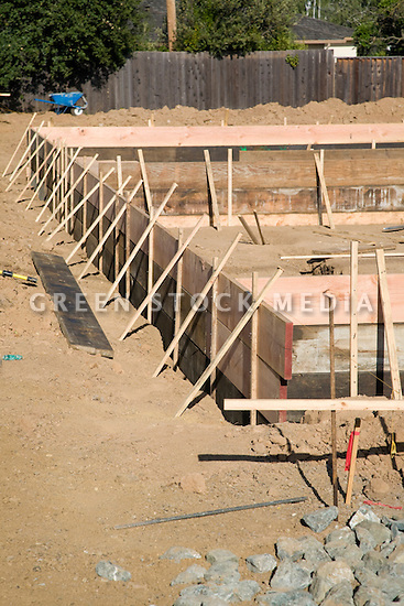 Wooden foundation forms green stock media for Concrete basement forms