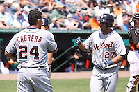 Detroit Tigers Jhonny Peralta (27) is greeted by Miguel Cabrera (24) after hitting a home run against the Miami Marlins during a spring training game at the Roger Dean Complex in Jupiter, Florida on March 25, 2013. Detroit defeated Miami 6-3. (Stacy Jo Grant/Four Seam Images)........