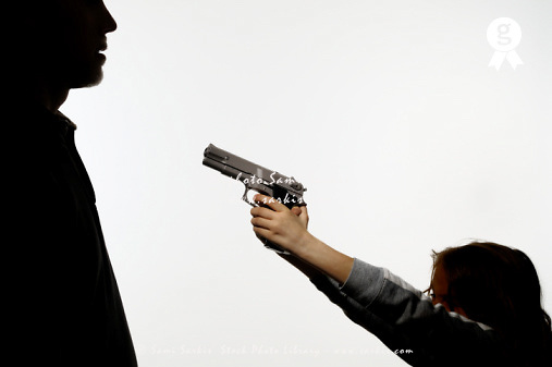 Girl (6-7) pointing gun at man (Licence this image exclusively with Getty: http://www.gettyimages.com/detail/sb10068346ci-001 )