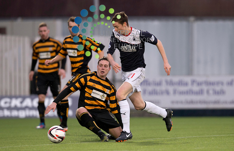 Connor McGrandles of Falkirk evades a challenge from Jason Marr of Alloa during the Scottish Championship match between Falkirk and Alloa at The Falkirk Stadium, Falkirk. 28 December 2013. Picture by Ian Sneddon / Universal News and Sport (Scotland). All pictures must be credited to www.universalnewsandsport.com. (Office) 0844 884 51 22.