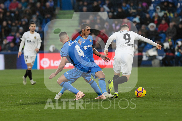 Getafe CF's Bruno Gonzalez and Valencia CF's Kevin Gameiro during La Liga match between Getafe CF and Valencia CF at Coliseum Alfonso Perez in Getafe, Spain. November 10, 2018.