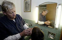 10-year-old Michael O'Reilly-Birtcher, right, has lotion applied to his nose by his adoptive father Thom O'Reilly at their home Thursday, Feb. 16, 2006, in Upper Arlington, Ohio. Because same-sex partners are barred from joint adoption in Ohio, O?Reilly and his partner of 25 years Harold Birtcher, went to Oregon three years ago to jointly adopt Michael. A bill introduced in the Ohio Legislature this month would bar all gays and lesbians from adoptions and foster care.<br />