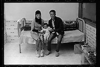 A Muslim couple poses with their son born with cleft lip at their home in Huangzhong before going to Xining, Qinghai province, for an operation organized by Smile Angel Foundation, August 2013. (Names withheld for privacy)