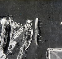 BNPS.co.uk (01202 558833)<br /> Pic:  Tooveys/BNPS<br /> <br /> Taken on 01/09/41 - Taken after the daylight raid on shipping at Rotterdam, showing the 'Noordam' class liner capsized, the result of a direct hit from a Blenheim.<br /> <br /> Dramatic photos showing a series of heart-pounding World War Two bombing raids from the pilot's perspective have come to light.<br /> <br /> They were taken from Blenheim bombers undertaking attacks on targets in Germany and Nazi-occupied Netherlands in 1941.<br /> <br /> Several capture the immediate aftermath of a direct hit, with flames and clouds of smoke signifying they had achieved their aim.<br /> <br /> The album, which contains almost 100 photos, has emerged for sale with Toovey's Auctions, of Washington, west Sussex.