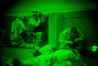 soldiers of C Company, 1st battalion, 506th, 101st airborne division brake through the roof top walls to position a sniper team while conducting a night raid with the purpose of arresting two suspected major figures of the Sunni insurgency in their sector in Eastern Ramadi, Al Anbar province, Iraq on WED Jan 11 2006. the mission was divided into two sections. SECTION ONE  with the prurpose of blocking the suspected insurgents from escaping and providing sniper fire for the area and SECTION 2 raiding the house were the two were suppose to be hiding. the two suspected insurgents were nt to9o be found.