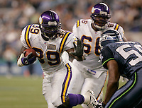 Vikings running back Adimchinobe Echemandu #39 carries the ball during NFL Preseason action Seattle Seahawks hosting Minnesota Vikings on Friday Sept. 2, 2005 at Qwest Field in Seattle, Wash.  (Kevin P. Casey/Wireimage.com)
