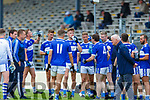John Spllane (4) pumps up Templenoe players Coiln Crowley, Gavin Crowley, Josh Crowley Holland and Kieran O'Neill rehydrate during the water break at their  SFC clash in Fitzgerald Stadium on Friday evening