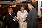 Captain Paul J. Matthews, Angela L. Holder and Jerome Gray share a laugh.