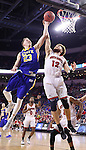 SIOUX FALLS, SD: MARCH 6: Reed Tellinghuisen #23 of South Dakota State shoots past South Dakota defender Trey Burch-Manning #12 during the Summit League Basketball Championship on March 6, 2017 at the Denny Sanford Premier Center in Sioux Falls, SD. (Photo by Dick Carlson/Inertia)