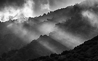 The sun fights through cloud cover over Costa Rica's central highlands.