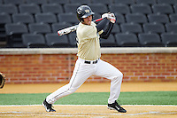 Grant Shambley (43) of the Wake Forest Demon Deacons follows through on his swing against the Marshall Thundering Herd at Wake Forest Baseball Park on February 17, 2014 in Winston-Salem, North Carolina.  The Demon Deacons defeated the Thundering Herd 4-3.  (Brian Westerholt/Four Seam Images)