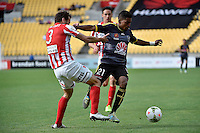 Roy Krishna and Robbie Wielaert in action during the A League - Wellington Phoenix v Melbourne City at Westpac Stadium, Wellington, New Zealand on Sunday 30 November 2014.