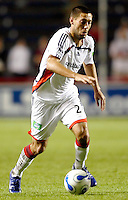 New England Revolution midfielder Clint Dempsey (2) dribbles the ball.  The Chicago Fire defeated the New England Revolution 2-1 in the quarterfinals of the U.S. Open Cup at Toyota Park in Bridgeview, IL on August 23, 2006...