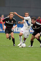San Jose Earthquakes' Dwayne De Rosario is chased by D.C. United's Brian Carroll and Ryan Nelsen. DC United defeated the San Jose Earthquakes 2 to 1 during the MLS season opener at RFK Stadium, Washington, DC, on April 3, 2004.