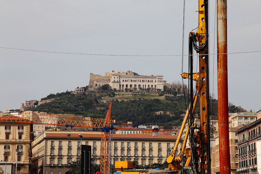 Napoli: In a colorful photo, a view of the Vomero hill, where is located the ancient Castel Sant&rsquo;Elmo, with the white buildings of the Certosa and of the San Martino museum in front. The photo was taken from a nord part of the town center, near the sea, and it includes some cranes.<br /> <br /> You can download this file for (E&amp;PU) only, but you can find in the collection the same one available instead for (Adv).